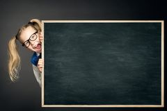 School Child Peep Out Blackboard, Student Girl Looking Chalkboard. School Child Peep Out Blackboard, Student Girl Looking behind Blank Chalkboard Advertisement stock photo