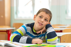 School child sitting on the bench Stock Image