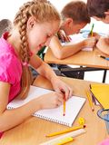 School child sitting in classroom. Royalty Free Stock Photo