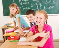 School child sitting in classroom. Stock Photo