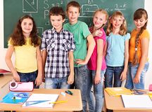 School child sitting in classroom. Group of school child sitting on desk in classroom royalty free stock photos