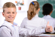 School. Child with teacher in classroom during lesson. concept of Royalty Free Stock Photography