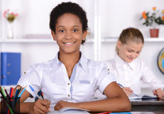 School. Child with teacher in classroom during lesson. concept of Stock Photos