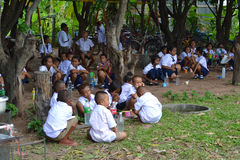 School children brushing their teeth. Young school children in a village in Thailand are being taught how to brush their teeth properly Royalty Free Stock Photo