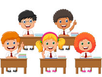 School children cartoon in classroom at lesson Stock Photography