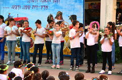 School children celebrating Shavuot (Pentecost). Israeli secular school children celebrating the Jewish holiday of Shavuot (Feast of Weeks) commemorating the Royalty Free Stock Image