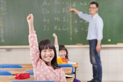 School children in classroom at lesson stock images