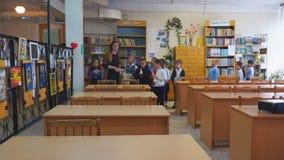School children come in to an empty class. Chapaevsk, Samara region, Russia - May 10, 2019: Elementary school of the city of Chapaevsk. Schoolchildren come in to stock video
