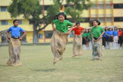 Free School Children Competing In Sack Race Royalty Free Stock Photography - 127777387