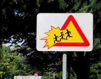 School children crossing zone, caution. Warning sign . School children crossing zone, caution. Warning traffic sign . tree background royalty free stock photography