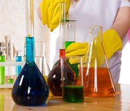 School children doing chemistry science experiment. Children doing chemistry science experiment with colorful reagents in school Stock Image