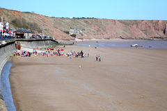 School children, Filey, Yorkshire. FILEY, NORTH YORKSHIRE, UK. APRIL 21, 2015. School children with teachers on the beach at Coble landing at Filey in North royalty free stock photo