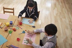 School children finger painting in art class, Beijing Stock Image