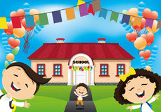 School children go to school. Cheerful school children go to school for the first time Royalty Free Stock Images
