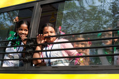 School children going home after classes at primary school by school bus. India Royalty Free Stock Photography
