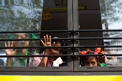 School children going home after classes at primary school by school bus. India Royalty Free Stock Photos