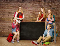 School Children Group, Kids Students around Blackboard, Boy Girl. School Children Group, Kids Students around Blackboard, Boys Girls over Brick Wall Background Stock Photography