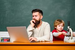 School children. Happy family. Back to school. Concept of education and teaching. Young or adult. Teacher and schoolboy. Using laptop in class. Homeschooling stock image