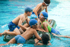 School children have fun in a swimming pool during a swimming le. Bangkok , Thailand – November 22, 2012: In a school in Bangkok, school children have fun in a Stock Photo