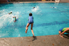 School children have fun in a swimming pool during a swimming le. Bangkok , Thailand – November 22, 2012: In a school in Bangkok, school children have fun in a Stock Photography