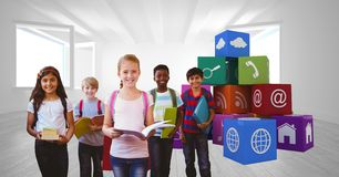 School children holding books by app icons royalty free stock images