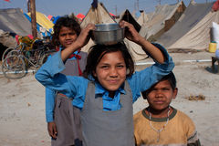 School children from India. Unidentified indian children play in the camp of the biggest festival in the world - Kumbh Mela, on January 26 2013 in Allahabad Stock Photos