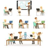 School children at the informatics and programming lesson set, teacher giving lesson in classroom, kids working on. Computers, learning robotics and programming Royalty Free Stock Images