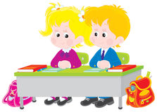 School children at lesson. Vector illustration of elementary school students sitting at a desk in a class Stock Images