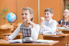 School children at lesson in classroom royalty free stock photo
