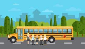 School children near school bus on highway Royalty Free Stock Photography