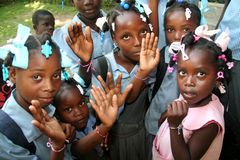 School children and new friendship bracelets. Royalty Free Stock Photography