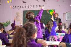 School children are participating actively in class Stock Images