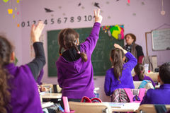 School children are participating actively in class Stock Image