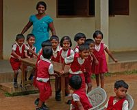 Small school school children playing while teaching at rural area in sri lanka stock image