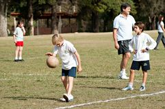 School children playing volleyball Royalty Free Stock Photo
