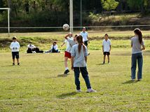 School children playing volleyball Stock Images
