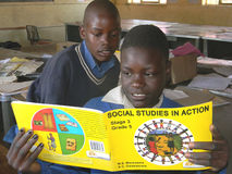 School children reading  social studies  book. Stock Photos