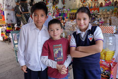 School Children, San Miguel, Mexico. Three school children, two brothers and a sister, together in San MIguel de Allende, Mexico, at a holiday market with sugar Stock Images