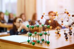 School children in a science class with a molecular model. Background image with soft focus. Education concept royalty free stock photo