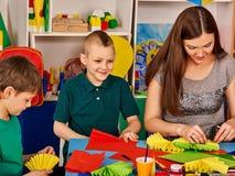 School children with scissors in kids hands cutting paper . Stock Photos