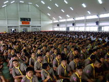 School children sit at assembly, Thailand. Stock Photos