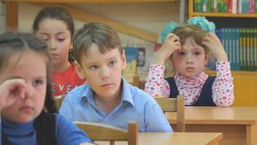 School children sit at their desks and listen to teachers. Chapaevsk, Samara region, Russia - May 10, 2019: Elementary school of the city of Chapaevsk stock footage