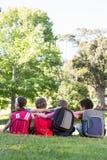 School children sitting on grass Royalty Free Stock Photography