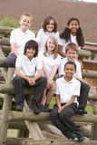 School Children Sitting On Benches Outside Royalty Free Stock Images