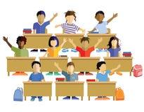School Children Sitting at their Desks Stock Photography