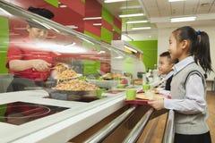 School children standing in line in school cafeteria Stock Photography