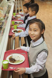 School children standing in line in school cafeteria Royalty Free Stock Images