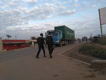 School children and Tanzanian trucks royalty free stock photo