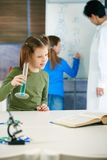 School children and teacher in science class Royalty Free Stock Image