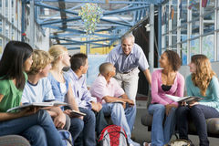 School children and their teacher in a class stock photos